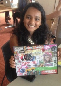 A proud BALI trainee shows off her Vision Board at a workshop from a guest speaker who allowed each girl to express her dreams and ideas creatively.